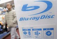 <p>A shopper walks past a Blu-ray Disc logo at an electronic shop in Tokyo February 18, 2008. A majority of U.S. households now know what a Blu-ray Disc is, while the number of households with a high-definition disc player has crossed the 10 million threshold, a new study shows. REUTERS/Issei Kato</p>