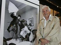 "<p>Scottish-born photojournalist Harry Benson, who photographed for ""Life"" magazine and currently shoots for ""Vanity Fair"" magazine, poses at the Pacific Design Center in Los Angeles March 24, 2008 with one of his most famous photographs. REUTERS/Fred Prouser</p>"