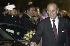 <p>Britain's Duke of Edinburgh, Prince Philip, walks round the back of the car after leaving the Upper Barrakka Gardens after planting a tree with Queen Elizabeth II (partly hidden) to commemorate their 60th wedding anniversary in Valletta November 20, 2007. REUTERS/Darrin Zammit Lupi</p>