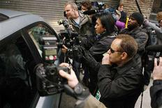 <p>Photographers swarm a car as it arrives to the parking garage underneath entertainer Jay-Z's apartment in the Tribeca area of New York April 4, 2008. REUTERS/Lucas Jackson</p>