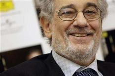 "<p>Spanish tenor Placido Domingo smiles during the media presentation of his album ""Pasion Espanola"" in Madrid April 8, 2008. REUTERS/Susana Vera</p>"
