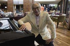 <p>File photo shows Dave Brubeck siting next to a piano in Monterey, California, September 22, 2007. REUTERS/Kimberly White</p>