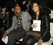 <p>U.S. singer Beyonce Knowles (R) and her companion Jay-Z pose for photographers before the start of the Emporio Armani's Fall/Winter 2008/09 men's collections during Milan Fashion Week January 13, 2008. REUTERS/Alessandro Garofalo</p>