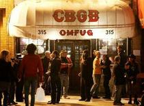 <p>Patrons of the music venue CBGB are seen outside the club in New York City October 14, 2006. CBGB is closing on October 15 after 33 years as a music venue. REUTERS/Lucas Jackson</p>