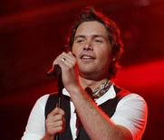"<p>""American Idol"" finalist Michael Johns performs in an undated photo courtesy of Fox. Johns finished in the bottom three for the first time on Thursday, and in a surprising result ended up being eliminated from the TV talent competition when fans cast the fewest votes for his rendition of Aerosmith's ""Dream On."" REUTERS/Handout</p>"