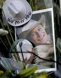 "<p>A photograph of Heath Ledger from the movie ""Brokeback Mountain"" rests among flowers at a makeshift memorial in front of the building where the actor died in New York January 23, 2008. REUTERS/Nicholas Roberts</p>"