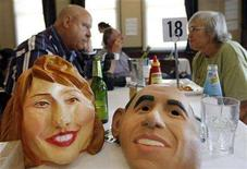 <p>Masks of Senators Hillary Clinton (L) and Barack Obama are pictured on the edge of a table of two participants at a Super Tuesday lunch function hosted by Democrats Abroad Australia at a Sydney bar February 6, 2008. REUTERS/Tim Wimborne</p>