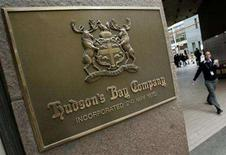 <p>A pedestrian walks past a Hudson's Bay company sign at the retailer's flagship Toronto store in this file photo. Hudson's Bay Co. said that its governor and chief executive Jerry Zucker died on Saturday of cancer. REUTERS/J.P. Moczulski</p>