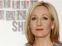 <p>Author J.K. Rowling poses at The South Bank Show Awards at Dorchester Hotel in London January 29, 2008. Rowling is expected to testify in a New York court on Monday in a bid to stop the publication of a fan's unofficial encyclopaedic companion to the boy wizard series. REUTERS/Anthony Harvey</p>