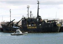 <p>A Canadian Fisheries patrol boat passes by the seized Sea Shepherd Conservation Society vessel Farley Mowat in Sydney, Nova Scotia, April 14, 2008. REUTERS/Paul Darrow</p>