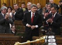 <p>Canada's Prime Minister Stephen Harper (C) stands to vote in the House of Commons on Parliament Hill in Ottawa March 13, 2008. REUTERS/Chris Wattie</p>