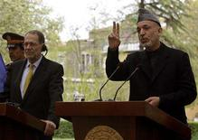 <p>Afghan president Hamid Karzai (R) gestures next to European Union's foreign policy chief Javier Solana during a news conference in Kabul April 21, 2008. REUTERS/Omar Sobhani</p>