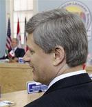 <p>Prime Minister Stephen Harper (R) waits for the start of a trilateral with U.S. President George W. Bush (L) and Mexico's President Felipe Calderon (not pictured) during the second day of the North American Leaders' Summit in New Orleans, Louisiana, April 22, 2008. REUTERS/Chris Wattie</p>