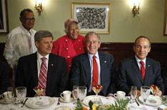 <p>Canada's Prime Minister Stephen Harper (L), U.S. President George W. Bush (C) and Mexico's President Felipe Calderon (R) sit down for breakfast during the second day of the North American Leaders' Summit in New Orleans, Louisiana, April 22, 2008. REUTERS/Chris Wattie</p>