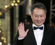 <p>Taiwan-born director Ang Lee waves as he arrives on the red carpet for the 44th Golden Horse Awards in Taipei December 8, 2007. REUTERS/Bobby Yip</p>