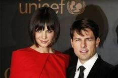<p>Tom Cruise e Katie Holmes a una cerimonia dell'Unicef ospitata da Gucci e Madonna alle Nazioni Unite a New York. REUTERS/Lucas Jackson</p>