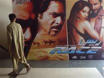 <p>A man walks past an Indian movie poster inside a cinema in Karachi April 21, 2008. Pakistan banned Indian films after going to war with its neighbour in 1965 but over the past few years, as relations between the nuclear-armed rivals have improved, authorities have been allowing a trickle of Indian films to be shown in cinemas. That has delighted movie fans and cinema operators but Pakistani film producers fear a flood of Indian films could mean the end of the local film industry. REUTERS/Athar Hussain/Files</p>