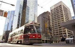 <p>A Toronto Transit Commission streetcar travels down King Street in Toronto April 10, 2005. Transit workers in Toronto went on strike at midnight on Friday after rejecting a tentative contract deal, shutting down bus, streetcar and subway service in Canada's most populous city. REUTERS/Peter Jones</p>