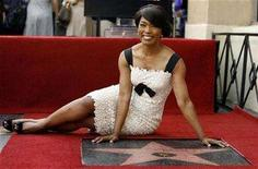 <p>Actress Angela Bassett poses after being honored with a star on the Walk of Fame in Hollywood, California March 20, 2008. REUTERS/Mario Anzuoni</p>