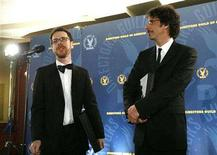 <p>Director Ethan Coen (L) answer a reporter's question, as his brother Joel Coen stands nearby at the 60th Annual Directors Guild of America Awards in Century City, California, January 26, 2008. REUTERS/Mario Anzuoni</p>
