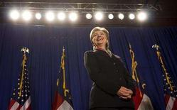 <p>Democratic presidential candidate Senator Hillary Clinton (D-NY) laughs while waiting to speak during a campaign stop in Raleigh, North Carolina April 29, 2008. REUTERS/Chris Keane</p>