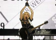"<p>Singer Madonna performs during a concert to celebrate the launch of her new album ""Hard Candy"" in New York April 30, 2008. REUTERS/Lucas Jackson</p>"