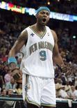 """<p>Игрок """"Нового Орлеана"""" Моррис Петерсон в третьей четверти матча 1/8 плей-офф НБА против """"Сан-Антонио"""" в Новом Орлеане 5 мая 2008 года. (REUTERS/Sean Gardner)</p>"""