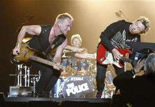 <p>Bassist and lead singer Sting (L), drummer Stewart Copeland (C) and guitarist Andy Summers perform during The Police Live in Concert in Tokyo February 13, 2007. REUTERS/Issei Kato</p>
