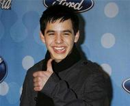"<p>Finalist David Archuleta from Murray, Utah poses at the American Idol Top 12 party honoring the finalists in the ""American Idol"" television reality series in Los Angeles, California March 6, 2008. REUTERS/Fred Prouser</p>"