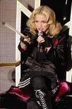 <p>La cantante  Madonna en una presentación para celebrar el lanzamiento de su disco 'Hard Candy' en París, 6 mayo 2008.La estrella pop Madonna (en la foto) comenzará su nueva gira internacional el 23 de agosto en Cardiff, Gales, anunció la artista el jueves en su página de internet. La gira 'Sticky and Sweet', que tendrá lugar tras la salida a la venta de su último y exitoso álbum 'Hard Candy', también visitará Francia, Alemania, Holanda, Italia y Gran Bretaña en agosto y septiembre. Photo by Benoit Tessier/Reuters  REUTERS/Benoit Tessier  (FRANCE)</p>