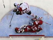 <p>Canada's Rick Nash (61) scores the game winning goal on Norway's goalie Pal Grotnes during the third period of action at the 2008 IIHF World Hockey Championships in Halifax, May 8, 2008. REUTERS/Paul Darrow</p>