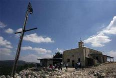 <p>Arabs stand outside a church in Iqrit, northern Israel, May 10, 2008, as part of an annual pilgrimage to a village whose residents were ordered out by Jewish fighters during the 1948 Arab-Israeli war. The villagers, Arab citizens of Israel, have long demanded a right to return to the site to live. REUTERS/Ammar Awad</p>