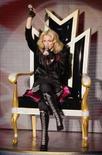 <p>A cantora Madonna faz show para celebrar o lançamento de seu novo álbum 'Hard Candy', dia 6 de maio, em Paris. Madonna não vai comparecer à última sessão do tribunal que decidirá sobre a sua adoção de uma criança do Malaui. Ela está muito ocupada com outros compromissos, disse o advogado da cantora na terça-feira. Photo by Benoit Tessier</p>