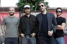 <p>Members of Coldplay, drummer Will Champion (L), guitarist Jonny Buckland (2nd L), lead singer Chris Martin, and bass guitarist Guy Berryman (R) pose before a news conference in Buenos Aires February 22, 2007. REUTERS/Enrique Marcarian</p>