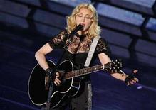 "<p>Singer Madonna performs during a concert to celebrate the launch of her new album ""Hard Candy"" in Paris May 6, 2008. REUTERS/Benoit Tessier</p>"