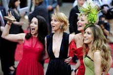 "<p>Actresses (L-R) Kristin Davis, Cynthia Nixon, Kim Cattrall and Sarah Jessica Parker arrive for the world premiere of ""Sex And The City: The Movie"" at Leicester Square in London May 12, 2008. REUTERS/Dylan Martinez</p>"