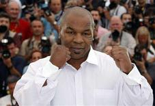 "<p>Former world heavyweight champion Mike Tyson poses during a photocall for the documentary film ""Tyson"" by U.S. director James Toback at the 61st Cannes Film Festival May 17, 2008. REUTERS/Eric Gaillard</p>"
