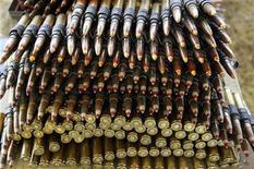 <p>A stack of .50 caliber tracer ammunition belts are stacked up at the Knob Creek Machine Gun Shoot near West Point, Kentucky April 9, 2005. Ammo prices for many popular guns have more than tripled in the last three years, driven in large part by surging demand for metals in rapidly industrializing China. REUTERS/Rick Wilking</p>