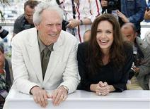 """<p>Director Clint Eastwood (L) and cast member Angelina Jolie pose during a photocall for the film """"The Exchange"""" at the 61st Cannes Film Festival May 20, 2008. REUTERS/Vincent Kessler</p>"""
