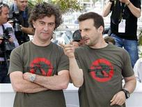 "<p>French producer Mathieu Kassovitz (R) poses with director Jean-Stephane Sauvaire during a photocall for the film ""Johnny Mad Dog"" at the 61st Cannes Film Festival May 20, 2008. REUTERS/Vincent Kessler</p>"