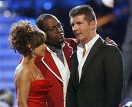 "<p>Show judges Paula Abdul, Randy Jackson and Simon Cowell arrive onstage for the finale of ""American Idol"" at the Nokia Theatre in Los Angeles May 21, 2008. REUTERS/Mario Anzuoni</p>"