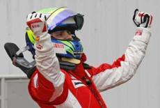 <p>Piloto de F1 Felipe Massa comemora após tirar a pole-position para o Grande Prêmio de Mônaco de Fórmula 1 em Monte Carlo. Photo by Robert Pratta</p>