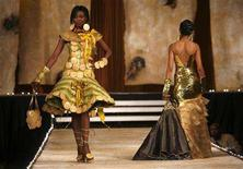 "<p>Models present creations of Nigerian designer Bayo Adegbe during the ""Fashion for Peace"" show in Nairobi May 24, 2008. Picture taken May 24, 2008. REUTERS/Radu Sigheti</p>"