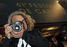 "<p>German director Wim Wenders photographs arrivals before the screening of the his ""The Palermo Shooting"" at the 61st Cannes Film Festival May 24, 2008. REUTERS/Jean-Paul Pelissier</p>"