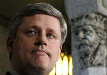 <p>Canada's Prime Minister Stephen Harper pauses after announcing that he has accepted the resignation of Foreign Affairs Minister Maxime Bernier on Parliament Hill in Ottawa May 26, 2008. REUTERS/Chris Wattie</p>