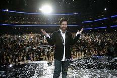 "<p>David Cook stands onstage at the Nokia Theatre after winning the finale of ""American Idol"" in Los Angeles May 21, 2008. REUTERS/Mario Anzuoni</p>"