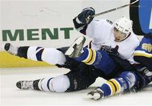 <p>Vancouver Canucks' Luc Bourdon hits the ice during an NHL hockey action against the St. Louis Blues in St. Louis in this October 20, 2006 file photo. Bourdon has been killed in a motorcycle crash in northern New Brunswick on May 29, 2008, according to local media reports. REUTERS/Peter Newcomb/Files</p>
