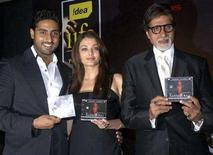 "<p>Bollywood actress Aishwarya Rai (C), her father-in-law, actor Amitabh Bachchan (R) and her husband, actor Abhishek Bachchan, unveil the soundtrack of their forthcoming movie ""Sarkar Raj"" in Mumbai May 29, 2008. REUTERS/Manav Manglani</p>"