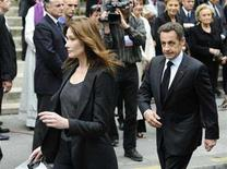 <p>France's President Nicolas Sarkozy (R) follows first lady Carla Bruni-Sarkozy after funeral services for fashion designer Yves Saint Laurent in Paris, June 5, 2008. REUTERS/Gonzalo Fuentes</p>