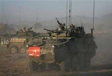 <p>Canadian armoured vehicles from the NATO-led coalition move during a combat operation against Taliban insurgents in the Sangsar area of Zhari district in Kandahar province, southern Afghanistan in this November 17, 2007 file photo. REUTERS/Finbarr O'Reilly</p>